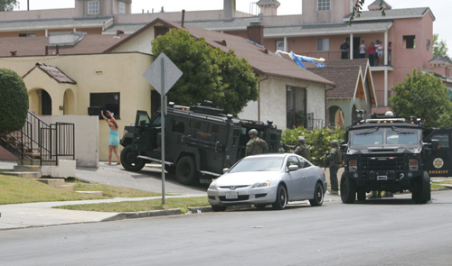 A female suspect surrenders to Sheriff's SWAT after being barricaded in a Highland Park home for hours Monday.  (EGP photo by Nancy Martinez)