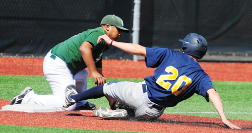 East Los Angeles College third baseman Michael Aguilar attempts to tag out College of the Canyons' J.D. Krauskopf Tuesday on a close play during the second inning. (Photo by Mario Villegas)