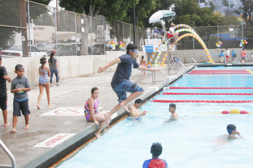 Children jump in the pool at the Glassell Park Pool as it inaugurates the Operation Splash summer program in 33 public swimming pools in L.A. (EGP photo by Jacqueline Garcia )