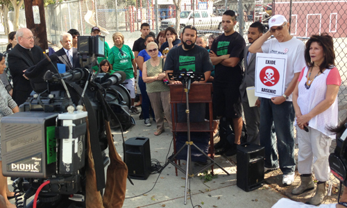 Mark Lopez from East Yard Communities for Environmental Justice and other members of the community demand that Exide complete testing and clean up all the homes and schools near Exide, during a press conference on Monday. (Courtesy of Angelo Logan EYCEJ)