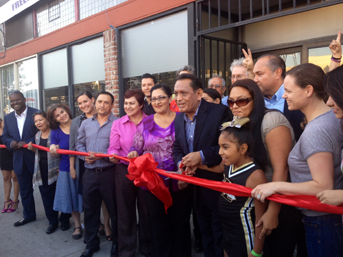 Councilmember Gil Cedillo, center, cuts  ribbon in front of his Highland Park office on Friday. (EGP photo by Jacqueline Garcia)