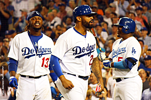 (Left to right:)Henley Ramirez and Matt Kemp celebrate their run scoring innings as Juan Uribe gets ready to contribute with his bat.  (EGP photo by Fred Zermeno)