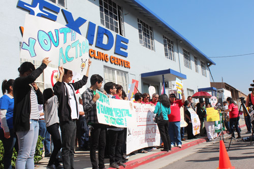 Community members protest outside Exide Technologies in Vernon earlier this year. (EGP photo by Fred Zermeno)