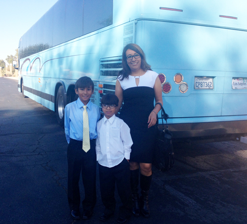 Isabel Medina and her two sons participate in a vigil before boarding the bus to Las Vegas where Medina will listen to Pres. Obama speak about his plans to give 5 million people a chance to avoid deportation. (EGP photo by Jacqueline Garcia)