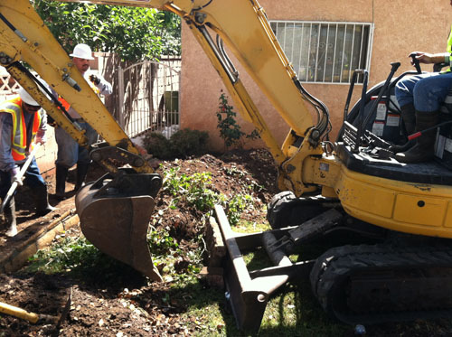 DTSC workers extract soil for sampling at homes near Exide's Vernon facility earlier this year.  (Courtesy of the Department of Toxic Substance Control )