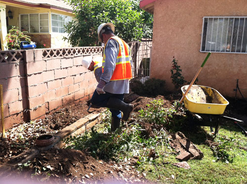 DTSC workers remove soil earlier this year at a home near Exide's Vernon facility. (Courtesy of the Department of Toxic Substance Control )