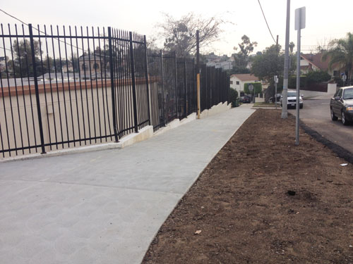 New Sidewalk Built Over Dirt Path to Santa Teresita School
