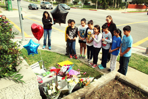 On Wednesday flowers, candles and letters were placed on the corner where Abel Castellanos worked as a crossing guard.  (EGP photo by Fred Zermeno)