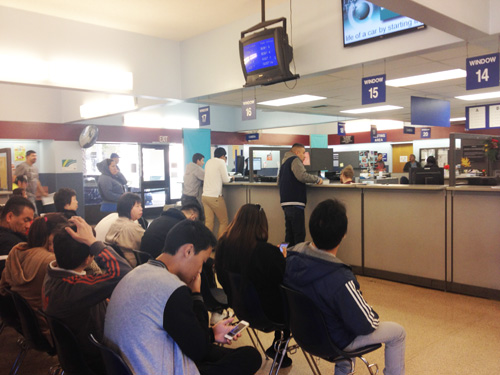People wait for their number to be called at the Lincoln Park DMV Tuesday. The location is one of 21 statewide that doesn't have a touch-screen computers for testing. (EGP photo by Jacqueline Garcia)