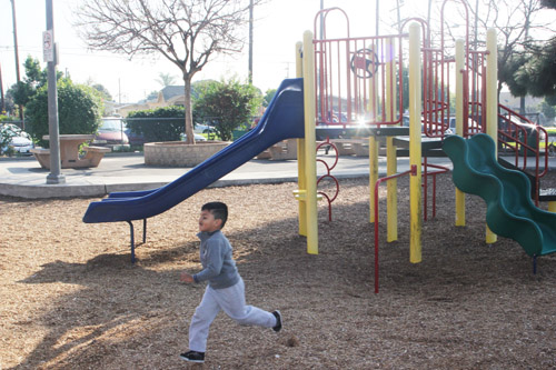 A young child runs around at Salazar Park, one of the locations near Exide tested for lead and arsenic. (EGP photo by Nancy Martinez)