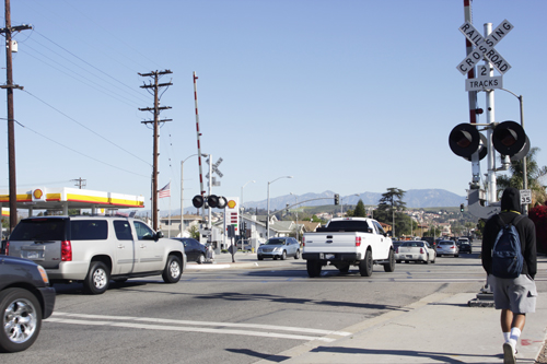 A student walks down Montebello Boulevard across railroad tracks on his way to school. (EGP photo by Nancy Martinez)
