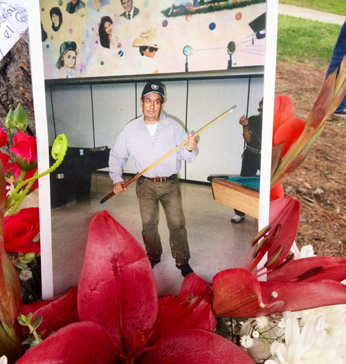 A photo of the victim of the fatal car accident at Salazar Park was placed in a shrine on Wednesday. (EGP photo by Jacqueline Garcia)