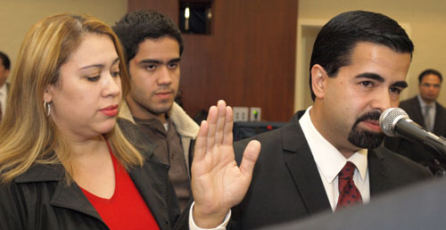 Former Bell Gardens Mayor Daniel Crespo, right, with his son, pictured center, and his wife Lyvette Crespo, left, during his swearing in ceremony in 2013. (EGP News photo archive)