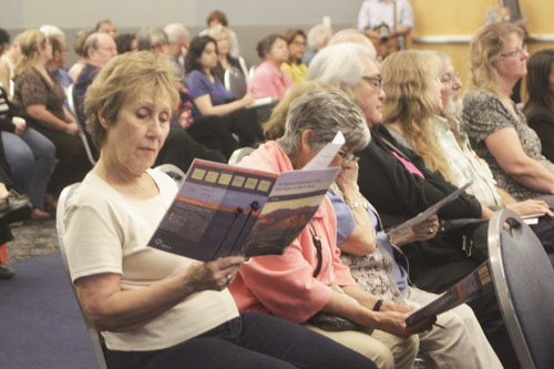 A woman reads a Metro pamphlet on the SR-710 North study during a forum at CSULA Monday. (EGP photo by Nancy Martinez)