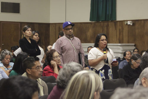 Boyle Heights resident Terry Cano shared her concerns with the way DTSC handled the Exide plant in Vernon last week at Resurrection Church. (EGP photo by Nancy Martinez)