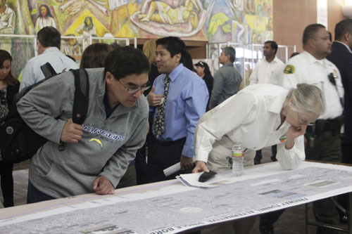 A map viewing at East Los Angeles College Saturday allowed residents who live along the proposed SR-710 Freeway project to view the impact on their communities. (EGP photo by Nancy Martinez)