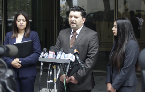 Lyvette Crespo's attorney Eber Bayona, center, maintained his client's innocence outside the Clara Shorthridge Foltz Criminal Justice Center in downtown Los Angeles.   (EGP photo by Nancy Martinez)
