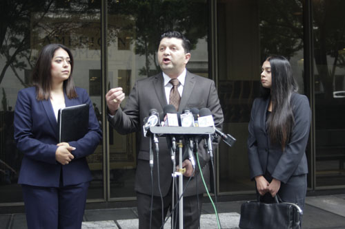 Lyvette Crespo's attorney Eber Bayona, center, maintains his client's innocence outside the Clara Shorthridge Foltz Criminal Justice Center in downtown Los Angeles . (EGP photo by Nancy Martinez)