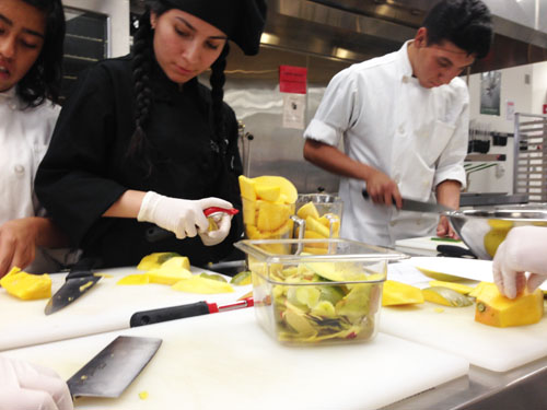 Students at the Applied Technology Center chop and prepare ingredients for their student-run bistro.  (Montebello Unified School District)