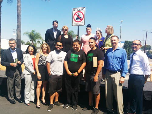 A group of community activists and elected officials unveil the 'No Idling' signs that will be placed around Commerce. (EGP photo by Jaqueline Garcia)