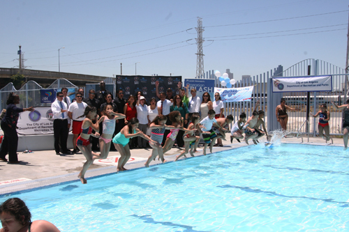Children get ready to jump in the pool during the kick off event in Lincoln Heights. (EGP photo by Jacqueline Garcia)