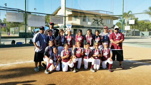 The Bell Gardens All Star 10U Fastpitch Softball Team pose for a photo with their coaches after placing second in LA/South Bay district competition. (Courtesy of Alberto Lucero)