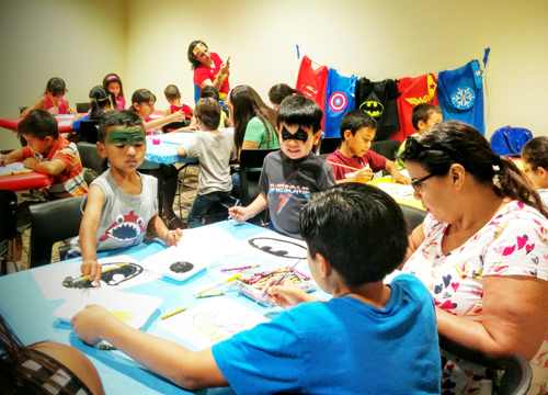 From Batman to The Hulk, young superheroes took over the Commerce Library Saturday during the city's first ever comic book convention.(EGP photo by Jacqueline Garcia)