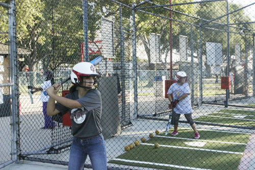 Bell Gardens All-Stars player Natalie Bracken, pictured left, gets ready to swing during batting practice Monday. (EGP photo by Nancy Martinez)