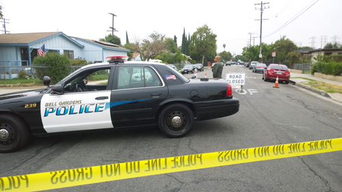 Bell Gardens Police closed off streets near the 6000 block of Live Oak Avenue where a previously convicted felon barricaded himself.  (EGP photo by Nancy Martinez)