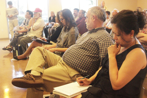 Eastside resident takes notes during a discussion with health experts Monday on the SR710 North project's draft environmental impact report at the East Los Angeles Library. (EGP photo by Nancy Martinez)