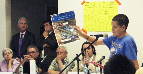 Jose Anthony Guitierrez holds up a map depicting how close he lived to the Exide Technologies plant in Vernon during a public meeting last week.  (EGP photo by Nancy Martinez)
