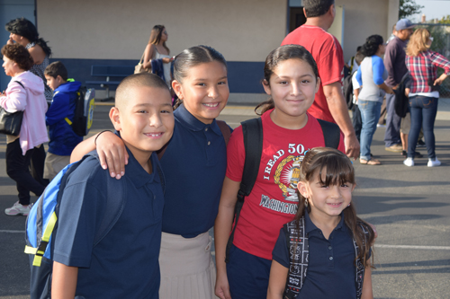 Students at Washington Elementary in Montebello can't hide their eager smiles during their first day of school Monday.   (Montebello Unified School District)