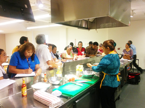 Instructor Laura Gonzalez teaches her students how to cook healthier traditional meals.  (EGP photo by Jacqueline Garcia)