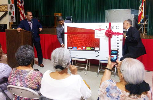 Councilman Cedillo surprises the seniors at the Lincoln Heights Senior Center Monday presenting them with a new 65-inch HD Television. (EGP photo by Jacqueline Garcia)