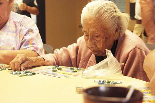 Maria Colmenares, 94, keep her eyes on her playing card during a game of loteria at the Bell Gardens Senior Center.  (EGP Photo by Nancy Martinez)