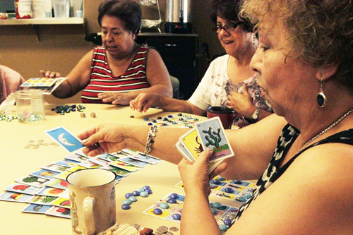 (Left to right): Irma Huerta, Maria Guzman and Andra Arenteria play loteria and talk about their grandchildren  at the Bell Gardens Senior Center.  (EGP photo by Nancy Martinez)