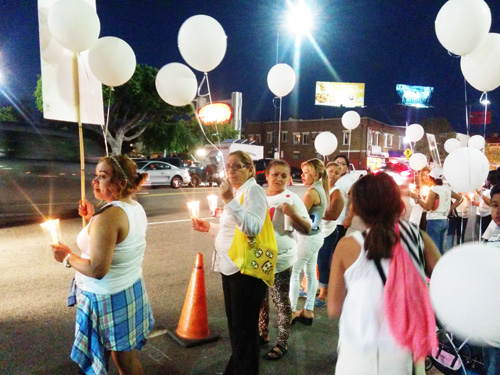 Participants at a vigil and march Friday - at the same crosswalk in Highland Park where a woman was struck and killed by a hit-and-run vehicle – demand justice and safer streets. (EGP photo by Jaccqueline Garcia)
