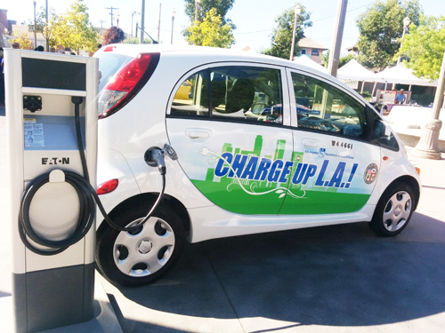 Electric cars get energy boost at local environmental resource fair. (EGP Photo by Jacqueline Garcia)