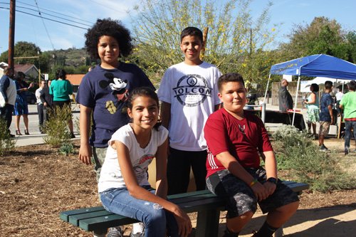 Students from La Merced Intermediate's Green Trojans club stand beside their newest drought-tolerant garden. (EGP photo by Nancy Martinez)