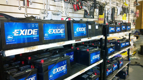 Exide car batteries fill the shelves at The Auto Supply Company store in East Los Angeles, not far from the controversial Vernon-based plant. (EGP photo by Nancy Martinez)