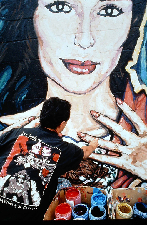 """Artist George Yepes in 1989 painting his iconic """"Lady of the Eastside"""" mural. (Photo courtesy of George Yepes)"""