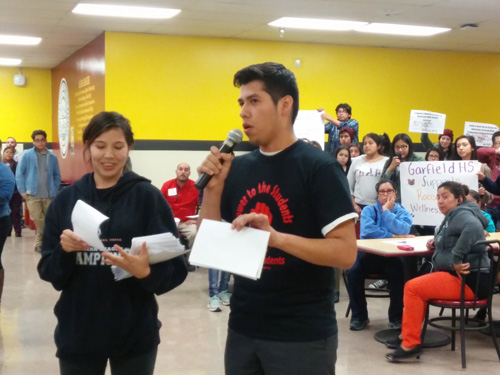 Roosevelt High School students hold petitions demanding LAUSD officials consider building a wellness center on campus during a meeting Monday. (EGP photo by Jacqueline Garcia)