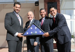 Left to right: Cal State LA student veteran Thomas Lawson, President William A. Covino, Rep. Xavier Becerra and alumnus and veteran Louis Guan with flag presented to the University by Becerra.  ( J. Emilio Flores/Cal State LA)