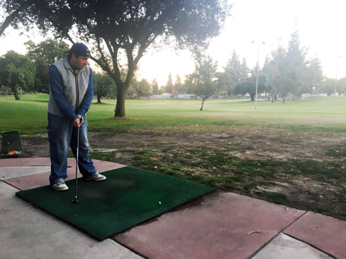 Fabian Anon takes a swing at the Bell Gardens Golf Course on Monday afternoon. (EGP photo by Nancy Martinez )
