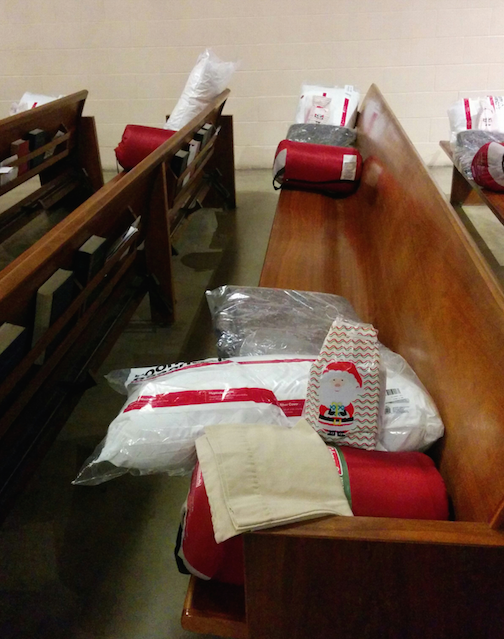 A pillow, a sleeping bag and toiletries were placed on every pew of the church. (EGP photo by Jacqueline García)