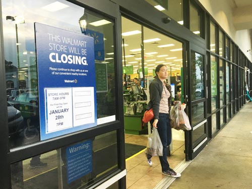 A sign posted outside the Bell Gardens Walmart Neighborhood Market says will be closing next week. (EGP photo by Nancy Martinez)