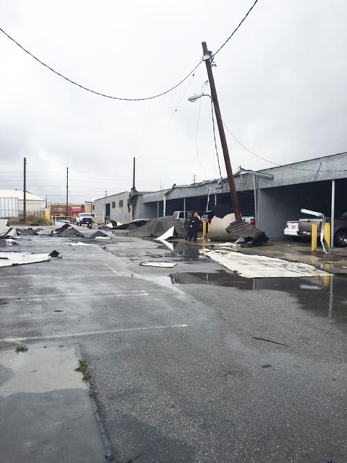 An El Niño storm-driven funnel-shaped cloud caused extensive damage to a number of Vernon businesses and parked vehicles.