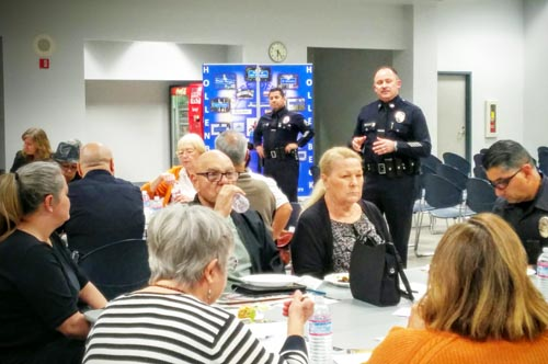 Participants dialogue with Hollenbeck police officers during a workshop in Boyle Heights. (EGP photo by Jacqueline Garcia)