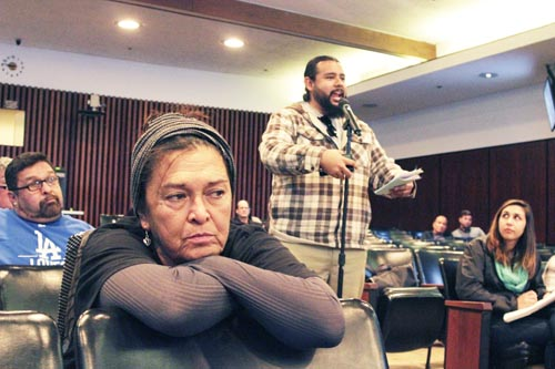 Eastside resident Doelorez Mejia, left, accuses DTSC of not listening to the community during public hearing in Commerce. (EGP photo by Nancy Martinez)