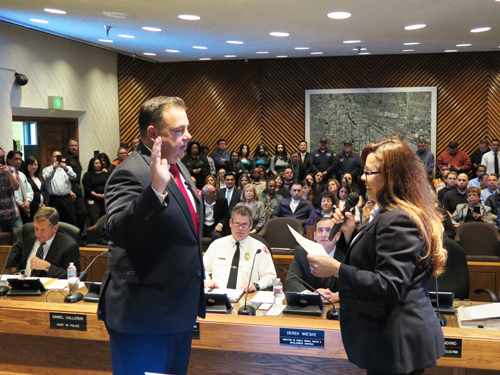 Carlos R. Fandino, left, was sworn-in as Vernon city administrator by Vernon City Clerk Maria Ayala during Tuesday's city council meeting. (City of Vernon)